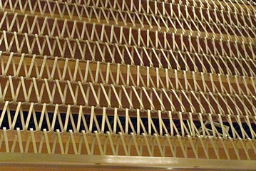 Brass conveyor belt mesh is installed on the building.