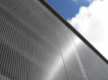 Cable metal mesh is used as flat facade cladding and reflects sunlight.