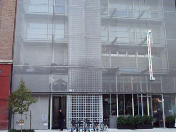 Conveyor belt mesh is used as facade cladding for a building.