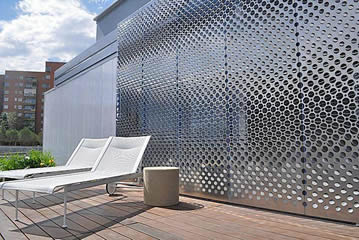 Perforated metal mesh with different sizes holes used for the building facade cladding.