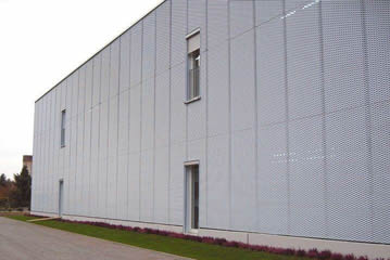 Expanded metal mesh used for the building wall directly.