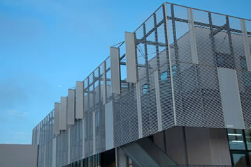 Expanded metal mesh is installed on the upper part of a building as the cladding.