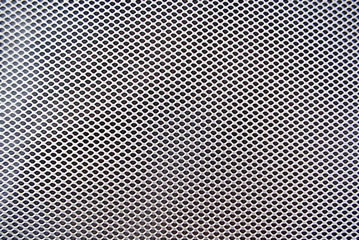 Expanded metal mesh with small holes.