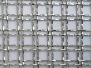 A piece of hard mesh with square holes.