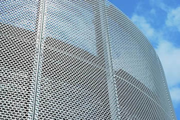Oval holes perforated metal mesh used for the building facade cladding.