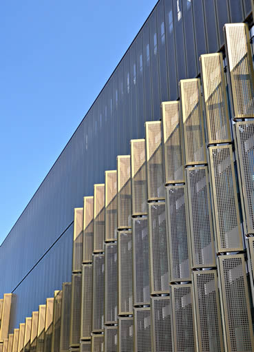 Many pieces of rectangle perforated metal mesh with copper plating surface treatment are used as the building cladding.