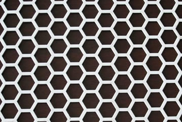 Perforated metal mesh with hexagonal holes.