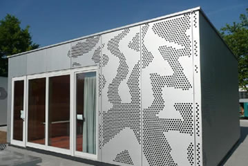 A house is made of perforated metal mesh with beautiful pictures.