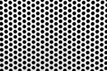 Perforated metal mesh with round holes.