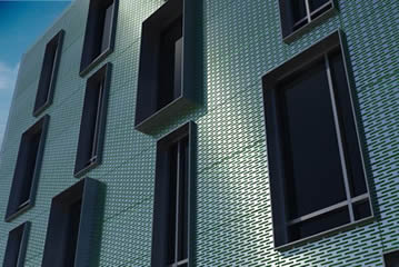 Slotted hole perforated metal mesh used for the building facade cladding.